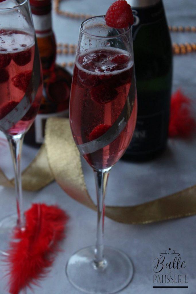 Cocktail : champagne, framboises, triple sec